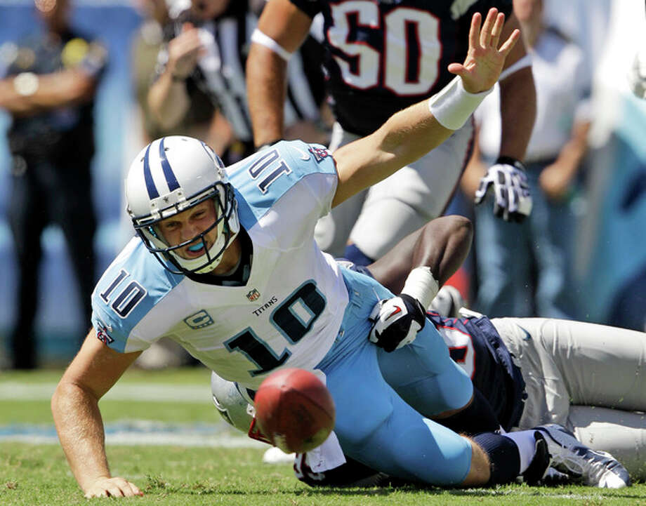 Tennessee Titans quarterback Jake Locker (10) loses the ball as he is hit by New England Patriots defensive end Chandler Jones (95) in the second quarter of an NFL football game, Sunday, Sept. 9, 2012, in Nashville, Tenn. New England Patriots linebacker Dont'a Hightower recovered the ball and ran for a touchdown. (AP Photo/Wade Payne) / FR23601 AP