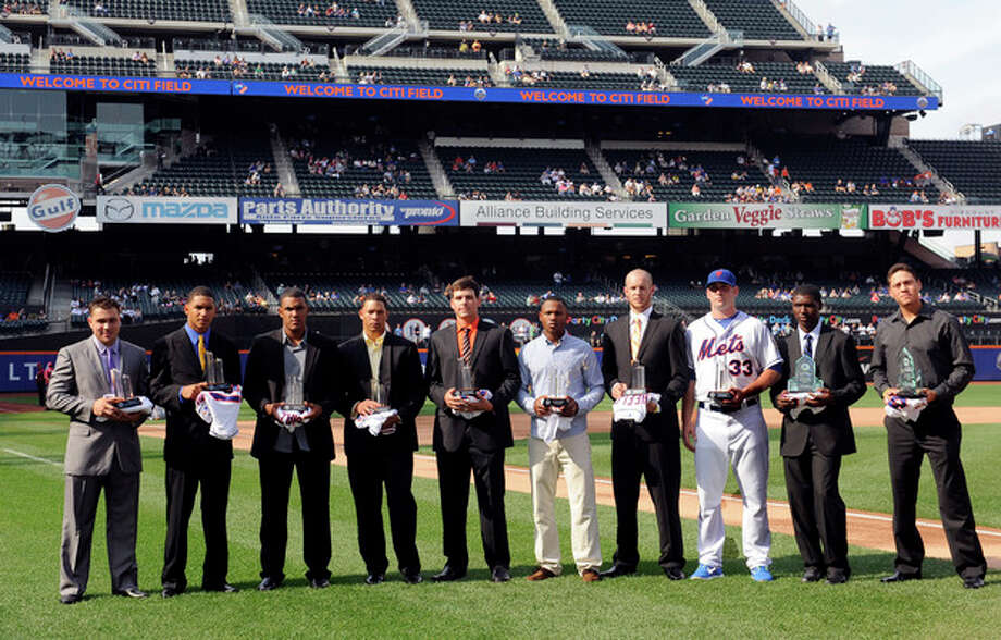 The New York Mets rookie players are honored with the 2012 Sterling Equities Awards before the baseball game against the Atlanta Braves on Saturday, Sept. 8, 2012, at Citi Field in New York. From left are Vincente Lupo, Yoryi Nuez, Miller Diaz, Hansel Orbles, Michael Fulmer, Alonzo Harris, Zack Wheeler, Matt Harvey, Rafael Montero and Wilmer Flores. (AP Photo/Kathy Kmonicek) / FR170189 AP