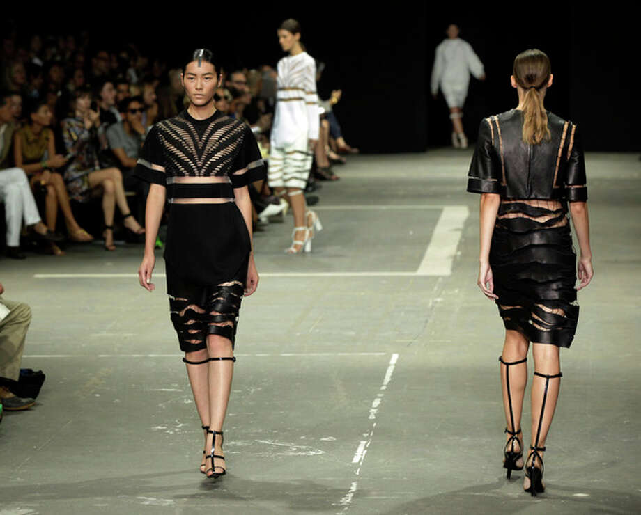 The Alexander Wang Spring 2013 collection is modeled during Fashion Week in New York, Saturday, Sept. 8, 2012. (AP Photo/Richard Drew) / AP