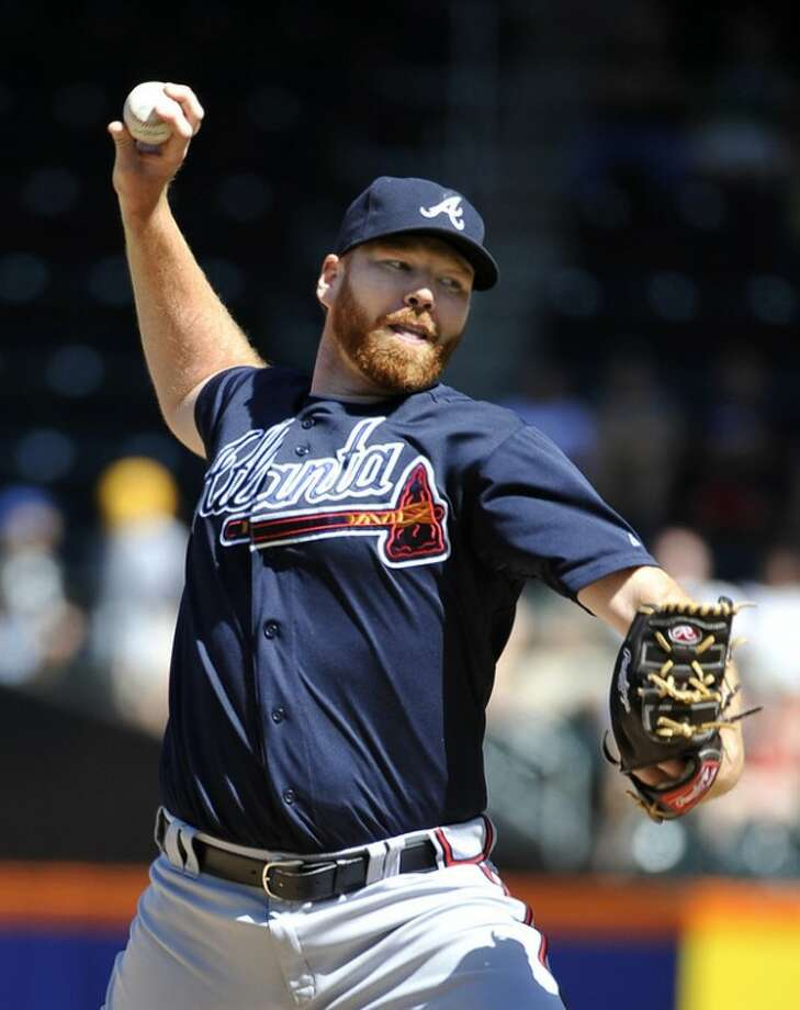 Atlanta Braves starting pitcher Tommy Hanson in the first inning of a baseball game against the New York Mets, Sunday, Sept. 9, 2012, at Citi Field in New York. (AP Photo/Kathy Kmonicek)