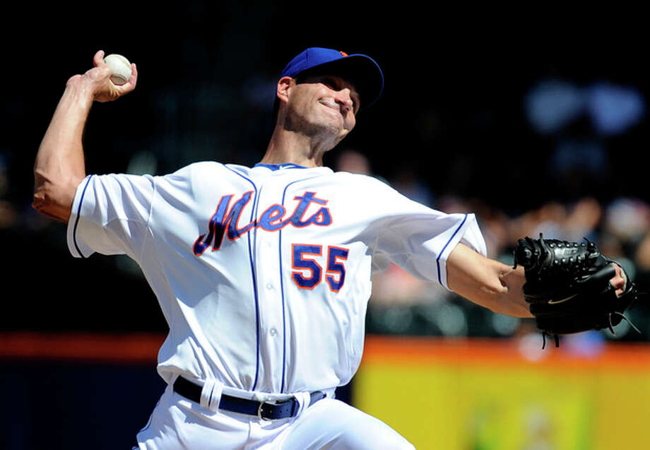 New York Mets starting pitcher Chris Young (55) throws against the Atlanta Braves in the first inning of a baseball game on Sunday, Sept. 9, 2012, at Citi Field in New York. (AP Photo/Kathy Kmonicek) / FR170189 AP