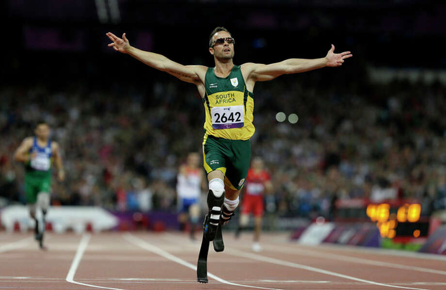 South Africa's Oscar Pistorius wins gold in the men's 400-meter T44 final at the 2012 Paralympics, Saturday, Sept. 8, 2012, in London. (AP Photo/Kirsty Wigglesworth) / AP