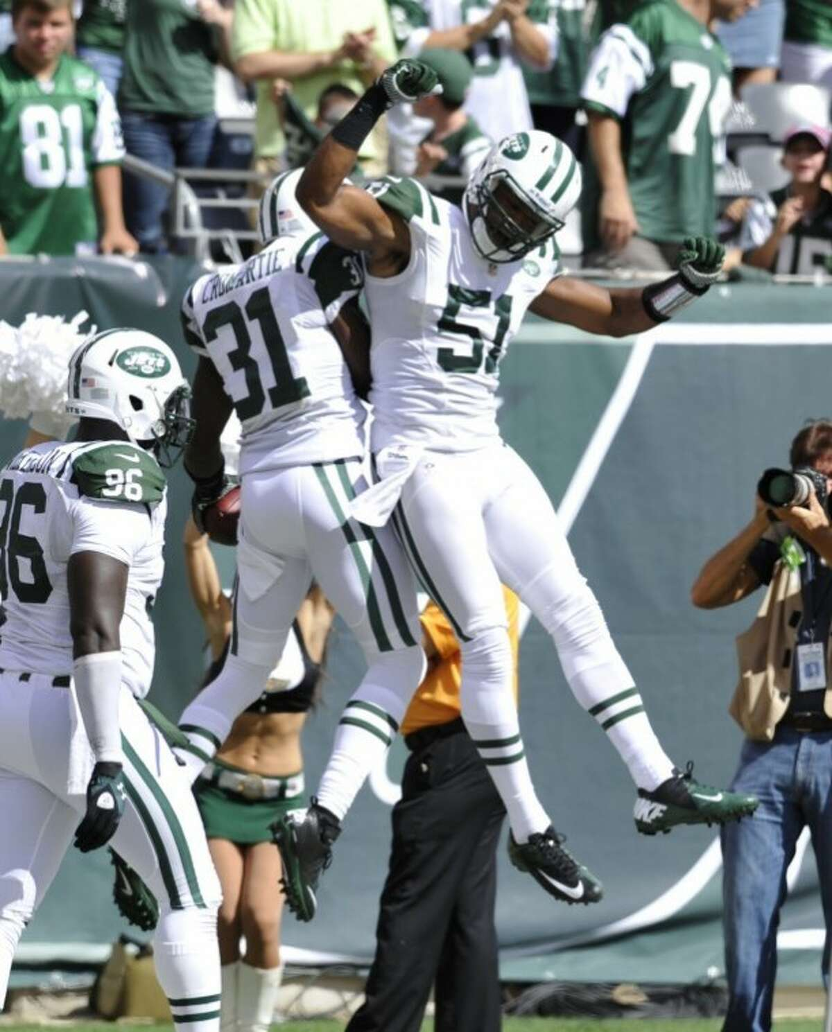 New York Jets cornerback Antonio Cromartie and linebacker Aaron Maybin (510 celebrate during the first half of an NFL football game between the New York Jets and the Buffalo Bills at MetLife Stadium Sunday, Sept. 9, 2012, in East Rutherford, N.J. (AP Photo/Bill Kostroun)