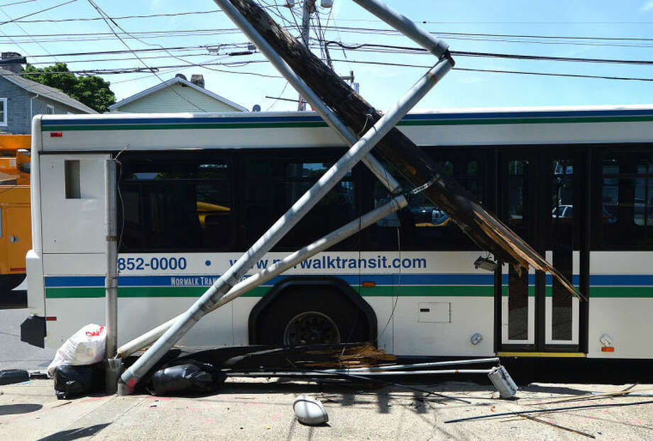 Hour Photo/Alex von Kleydorff Damage to a utilty pole at East Ave and Fort Point St caused by a wheels bus that crashed into it Wednesday afternoon