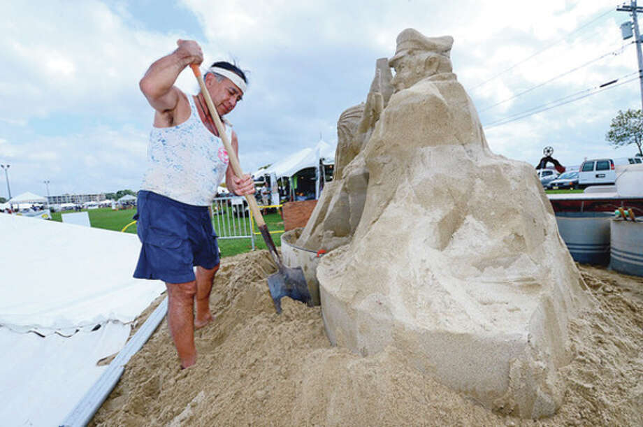 Alan Matsumoto builds a sand sculpture during the Norwalk Seaport Association 2012 Oyster Festival at Veteran's Memorial Park in Norwalk Saturday.Hour photo / Erik Trautmann / (C)2012, The Hour Newspapers, all rights reserved