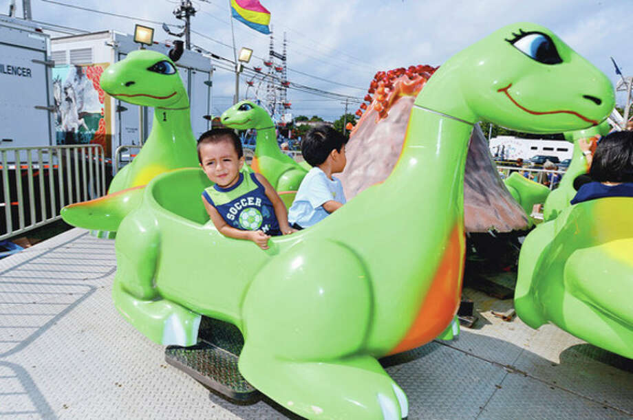 Roger Rosales and Allejandro Uvaldo enjoy the rides during the Norwalk Seaport Association 2012 Oyster Festival at Veteran's Memorial Park in Norwalk Saturday.Hour photo / Erik Trautmann / (C)2012, The Hour Newspapers, all rights reserved