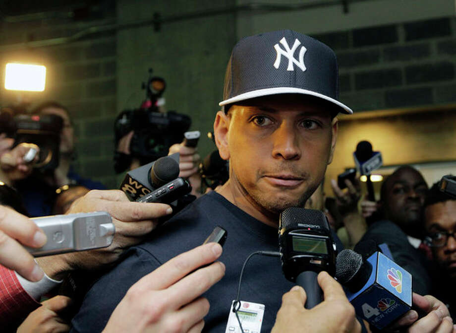 FILE - in this April 1, 2013, file photo, New York Yankees' Alex Rodriguez, who is on the disabled list after hip surgery, talks to reporters outside the Yankees' clubhouse in New York. A person familiar with the case tells The Associated Press Tuesday June 4, 2013 that the founder of a Miami anti-aging clinic has agreed to talk to Major League Baseball about players linked to performance-enhancing drugs. Alex Rodriguez, Ryan Braun, Nelson Cruz and Melky Cabrera are among the players whose names have been tied to the clinic. (AP Photo/Kathy Willens, File) / AP