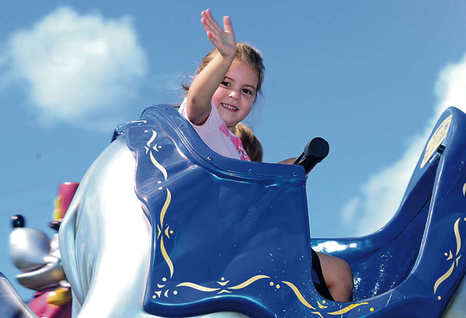 Maya Quade, 4, enjoys the 35th annual Oyster Festival at Veteran's Memorial Park Sunday. Hour photo / Erik Trautmann / (C)2012, The Hour Newspapers, all rights reserved