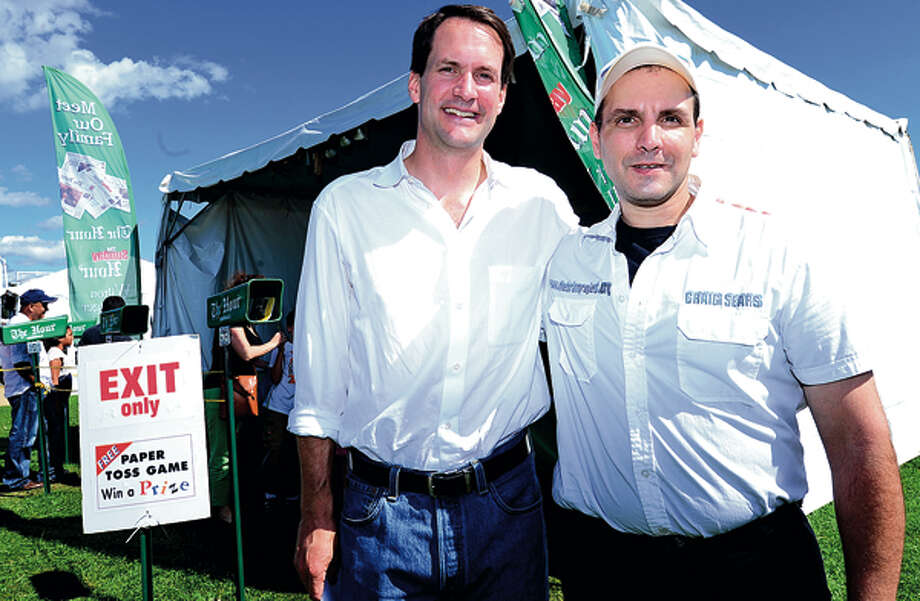 Craig Sears, right, thanks Congressman Jim Himes for his co-sponsorship of H.R. 2600, also known as The National Pediatric Acquired Brain Injury Plan Act of 2011, at the 35th annual Oyster Festival at Veteran's Memorial Park Sunday. Hour photo / Erik Trautmann / (C)2012, The Hour Newspapers, all rights reserved