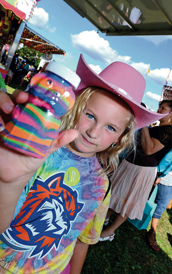 Brielle Renwick, 7, enjoys the 35th annual Oyster Festival at Veteran's Memorial Park Sunday. Hour photo / Erik Trautmann / (C)2012, The Hour Newspapers, all rights reserved
