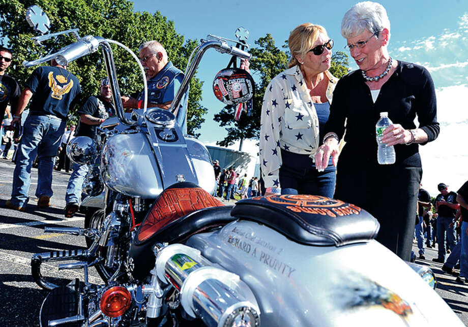 State Representative Debralee Hovey (D-112) and Lt. Governor Nancy Wyman look at motorcycles during the CT United Ride tribute which started out from Norden ParkSunday for the 12th annual motorcycle ride to benefit first responders and families affected by 9/11. Hour photo / Erik Trautmann / (C)2012, The Hour Newspapers, all rights reserved