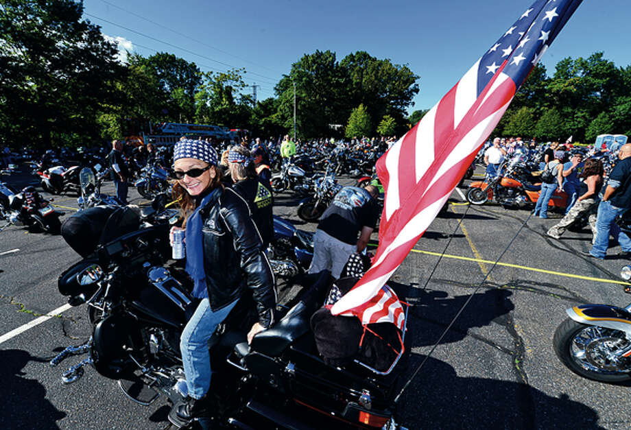 Susan Fezza and The CT United Ride tribute started out from Norden ParkSunday for the 12th annual motorcycle ride to benefit first responders and families affected by 9/11. Hour photo / Erik Trautmann / (C)2012, The Hour Newspapers, all rights reserved
