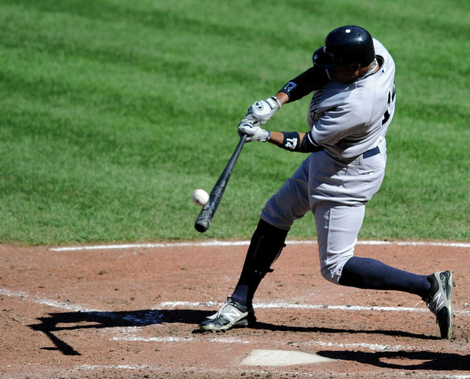 New York Yankees' Curtis Granderson hits a home run against the Baltimore Orioles during the sixth inning of a baseball game on Sunday, Sept. 9, 2012, in Baltimore. The Yankees won 13-3. (AP Photo/Nick Wass) / FR67404 AP