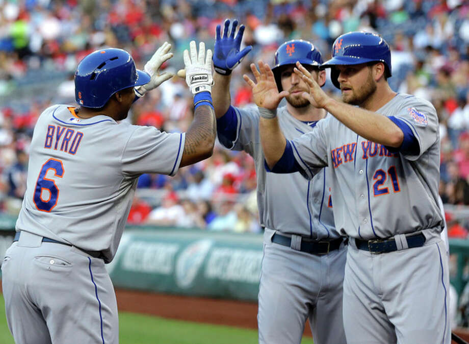 New York Mets' Marlon Byrd (6) celebrates with Ike Davis (29) and Lucas Duda (21) after Byrd's two-run home run during the second inning of a baseball game against the Washington Nationals at Nationals Park on Wednesday, June 5, 2013, in Washington. (AP Photo/Alex Brandon) / AP