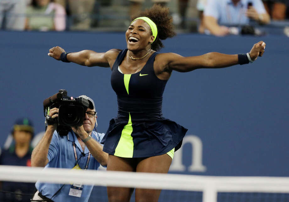 Serena Williams reacts after beating Victoria Azarenka, of Belarus, in the championship match at the 2012 US Open tennis tournament, Sunday, Sept. 9, 2012, in New York. (AP Photo/Charles Krupa) / AP