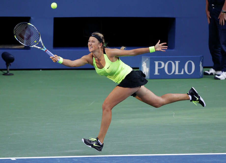 Victoria Azarenka, of Belarus, returns a shot to Serena Williams during the championship match at the 2012 US Open tennis tournament, Sunday, Sept. 9, 2012, in New York. (AP Photo/Kathy Willens) / AP