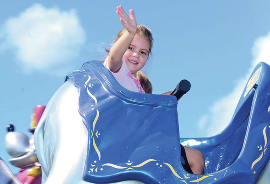 Maya Quade, 4, enjoys the 35th annual Oyster Festival at Veteran's Memorial Park Sunday.Hour photo / Erik Trautmann / (C)2012, The Hour Newspapers, all rights reserved