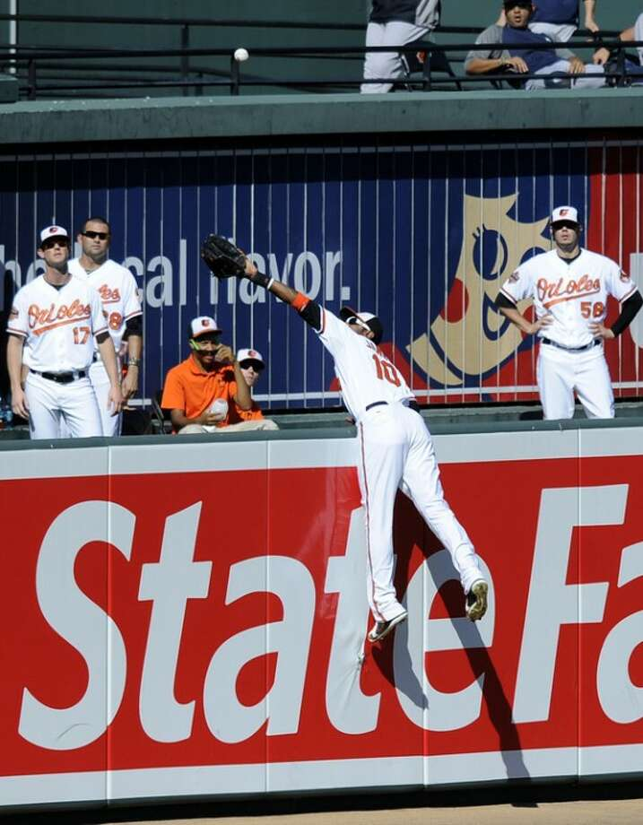 Baltimore Orioles center fielder Adam Jones (10) jumps in vain for a home run by New York Yankees' Curtis Granderson during the sixth inning of a baseball game on Sunday, Sept. 9, 2012, in Baltimore. The Yankees won 13-3. (AP Photo/Nick Wass)