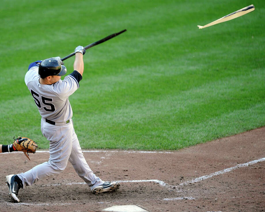 New York Yankees' Russell Martin breaks his bat as he singles in Alex Rodriguez to score during the eighth inning of a baseball game against the Baltimore Orioles, Sunday, Sept. 9, 2012, in Baltimore. The Yankees won 13-3. (AP Photo/Nick Wass) / FR67404 AP