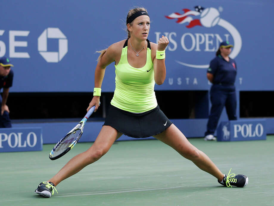 Victoria Azarenka, of Belarus, reacts while playing against Serena Williams during the championship match at the 2012 US Open tennis tournament, Sunday, Sept. 9, 2012, in New York. (AP Photo/Darron Cummings) / AP