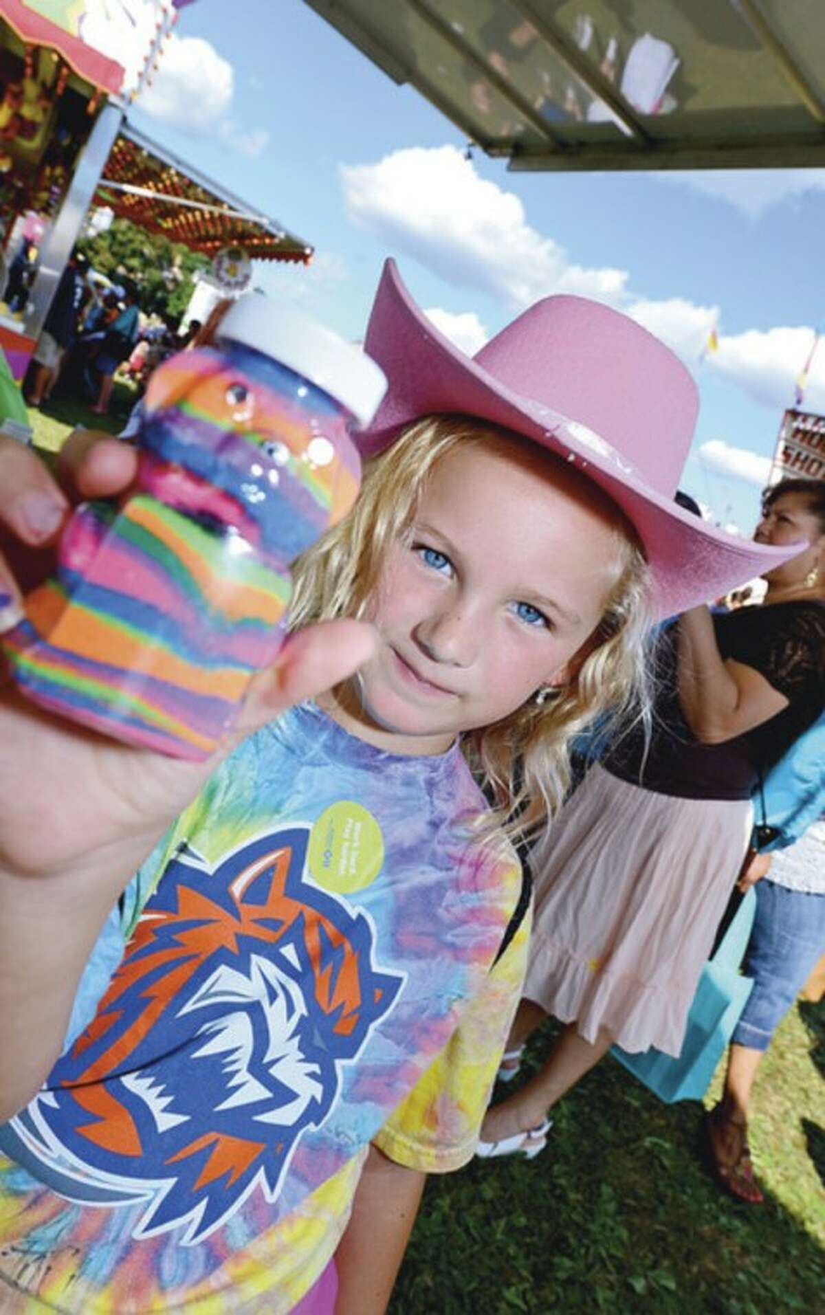 Brielle Renwick, 7, enjoys the 35th annual Oyster Festival at Veteran's Memorial Park Sunday. Hour photo / Erik Trautmann