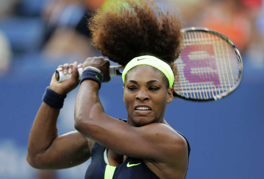 Serena Williams returns a shot to Victoria Azarenka, of Belarus, during the championship match at the 2012 US Open tennis tournament, Sunday, Sept. 9, 2012, in New York. (AP Photo/Mike Groll) / AP
