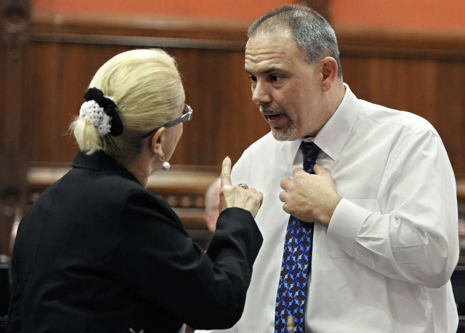 State Rep. Minnie Gonzalez, D-Hartford, left, reacts toward House Majority Leader Joe Aresimowicz, D-Berlin, after her speaking was cut during the final day of session at the Capitol in Hartford, Conn., Wednesday, June 5, 2013. Lawmakers wrap up a session that was dominated at the beginning and the end by issues related to the shooting at Sandy Hook Elementary School. (AP Photo/Jessica Hill)