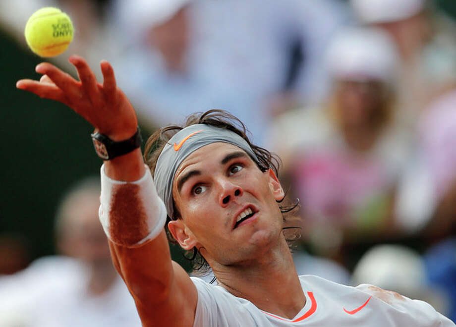 Spain's Rafael Nadal serves toSwitzerland's Stanisas Wawrinka during their quarterfinal match of the French Open tennis tournament at the Roland Garros stadium Wednesday, June 5, 2013 in Paris. Nadal won 6-2, 6-3, 6-1. (AP Photo/Christophe Ena) / AP