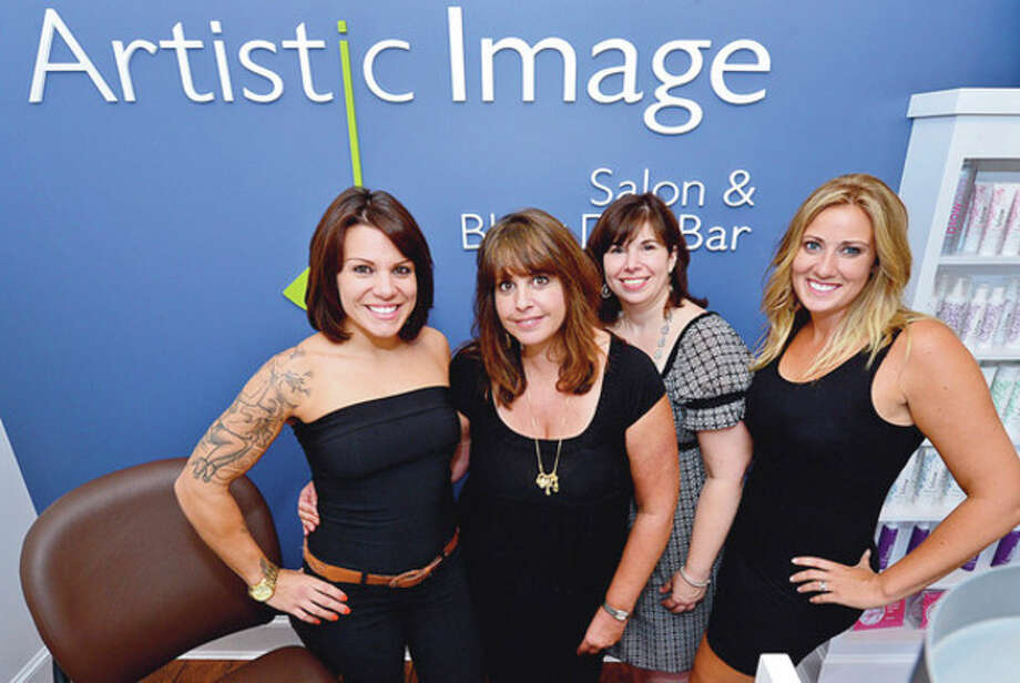 Hour photo / Erik TrautmannChristie Macaluso, Patty Tischio, Dina Lago and Lindsay Petropoulos of Artistic Image Salon and Blow Dry Bar held their grand re-opening Saturday. Artistic Image moved to Post Road West in Westport from its original location on East Avenue in Norwalk. / (C)2012, The Hour Newspapers, all rights reserved