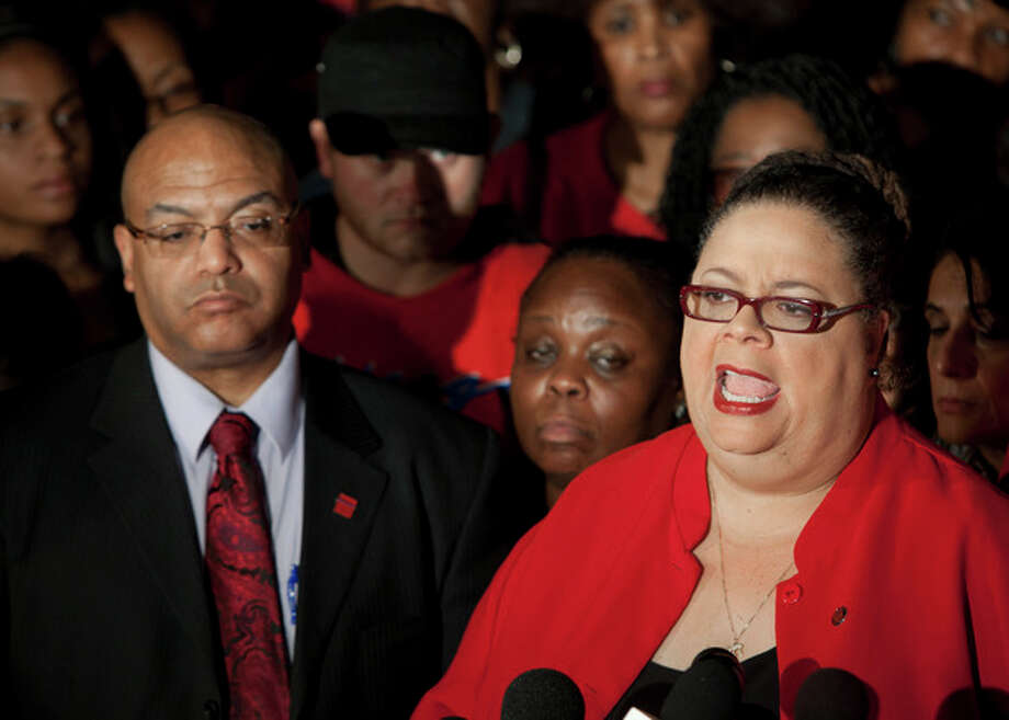 Chicago Teachers Union President Karen Lewis, right, tells reporters at a news conference outside the union's headquarters that the city's 25,000 public school teachers will walk the picket line Monday morning after final-day talks with the Chicago Board of Education failed to reach an agreement over teachers' contracts on Sunday, Sept. 9, 2012 in Chicago. (AP Photo/Sitthixay Ditthavong) / AP