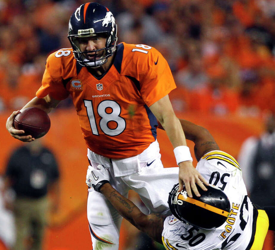 Denver Broncos quarterback Peyton Manning (18) is wrapped up by Pittsburgh Steelers linebacker Larry Foote (50) during the second quarter of an NFL football game, Sunday, Sept. 9, 2012, in Denver. (AP Photo/David Zalubowski) / AP