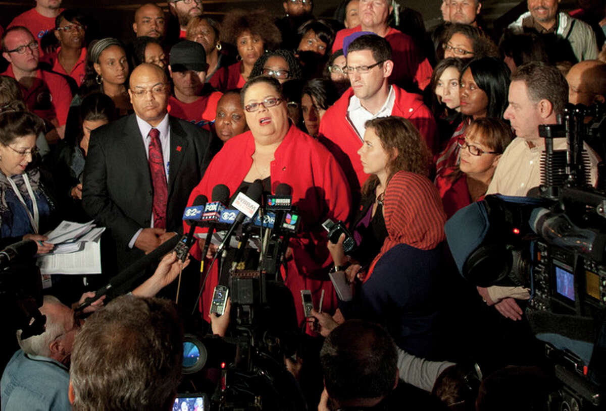 Chicago Teachers Union President Karen Lewis informs reporters at a news conference outside the union's headquarters in Chicago that the city's 25,000 public school teachers will walk the picket line Monday morning after talks with the Chicago Board of Education broke down on the evening of Sunday, Sept. 9, 2012. (AP Photo/Sitthixay Ditthavong)