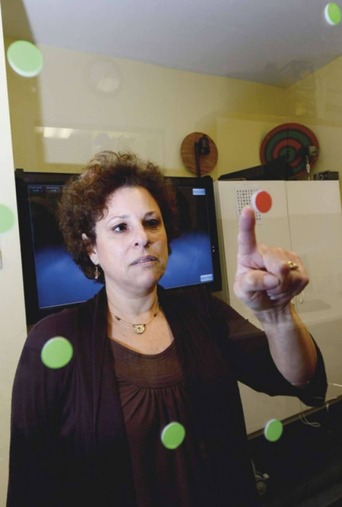 Debra Murray, therapist with The Center for Integrated Vision, works with providing eye exams for children to help determine whether they have visual learning disabilities.
