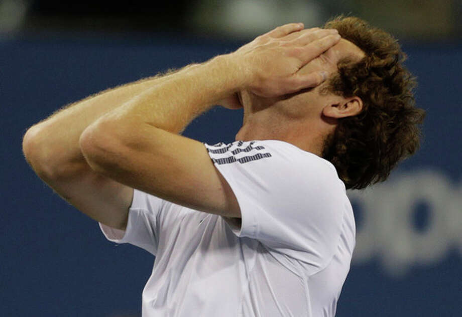 Britain's Andy Murray reacts after beating Serbia's Novak Djokovic in the championship match at the 2012 US Open tennis tournament, Monday, Sept. 10, 2012, in New York. (AP Photo/Charles Krupa) / AP