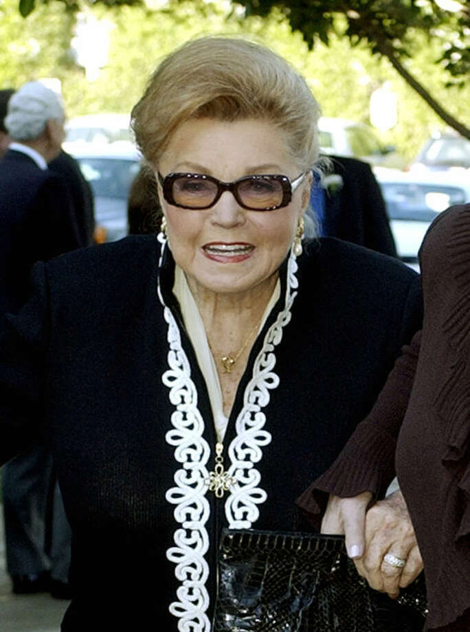 FILE - This Jan. 28, 2004 file photo shows Esther Williams at the funeral service for dancer/actress Ann Miller at St. Mel Catholic Church in Los Angeles' Woodland Hills area. According to a press representative, Williams died in her sleep on Thursday, June 6, 2013, in Beverly Hills, Calif. She was 91. (AP Photo/Reed Saxon, file)