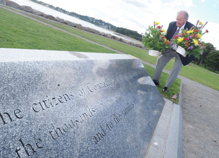 Hour photos / Matthew VinciPaul Kirwin, chairman of the fund for Connecticut's 9/11 Living Memorial at Sherwood Island Park, lays flowers at the memorial. Paul lost his son, Glen Davis Kerwin, at the World Trade Center on Sept. 11, 2001.