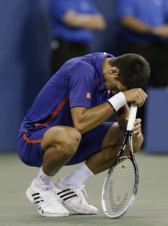 Serbia's Novak Djokovic reacts while playing Britain's Andy Murray during the championship match at the 2012 US Open tennis tournament, Monday, Sept. 10, 2012, in New York. (AP Photo/Darron Cummings)