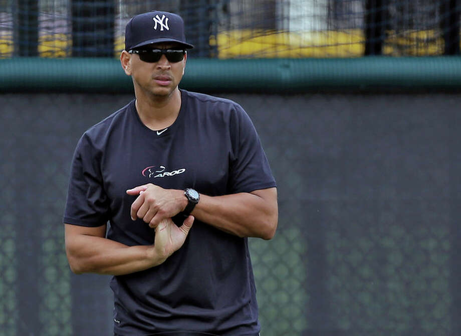 New York Yankees third baseman Alex Rodriguez stretches his wrist during a workout Wednesday, June 5, 2013, at the Yankees' minor league complex in Tampa, Fla. Major League Baseball has begun interviewing players linked to a Miami anti-aging clinic that allegedly sold performance-enhancing drugs and became the focus of the sport's investigation. Rodriguez is among more than a dozen players whose names have been tied to the now-closed clinic, Biogenesis of America.(AP Photo/Chris O'Meara) / AP