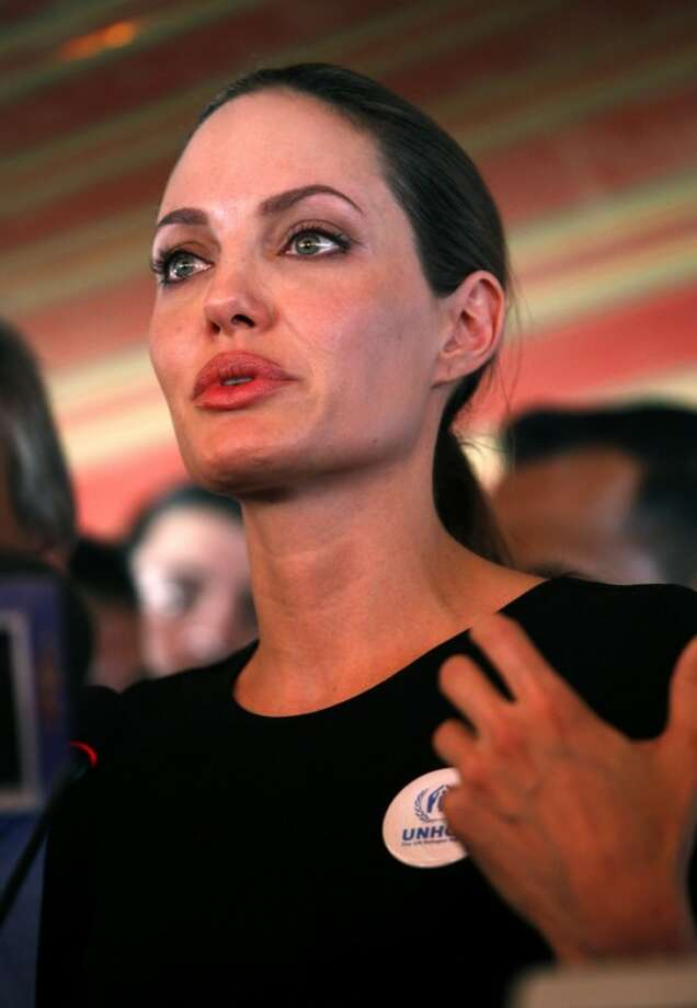 The U.N. refugee agency's special envoy, actress Angelina Jolie, speaks to the press during her visit to the Zaatari Syrian Refugees Camp, in Mafraq, Jordan, Tuesday, Sept. 11, 2012. The Hollywood star arrived on Tuesday morning in the Zaatari camp, which hosts about 27,000 Syrians displaced by the 18-month conflict. (AP photo/Mohammad Hannon)