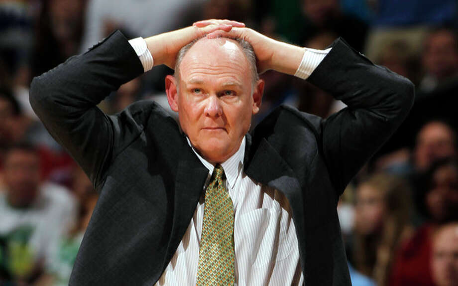 FILE - In this March 17, 2012 file photo, Denver Nuggets coach George Karl puts his hands on his head during an NBA game against the Boston Celtics in Denver. Karl is out as coach of the Nuggets. Team President Josh Kroenke confirmed in an email to The Associated Press on Thursday, June 6, 2013 that Karl's tenure was over just weeks after he was named the NBA's coach of the year. (AP Photo/David Zalubowsk, Filei) / AP