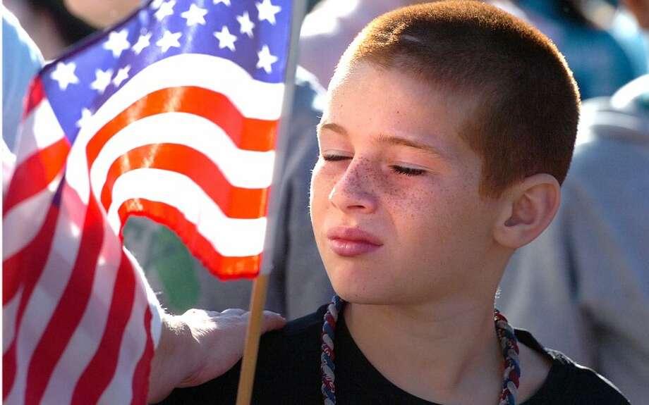 Hour Photo/ Alex von Kleydorff. Luca Piacenza who was born on September 11 2001 listens during a 9/11 program at West Rocks school