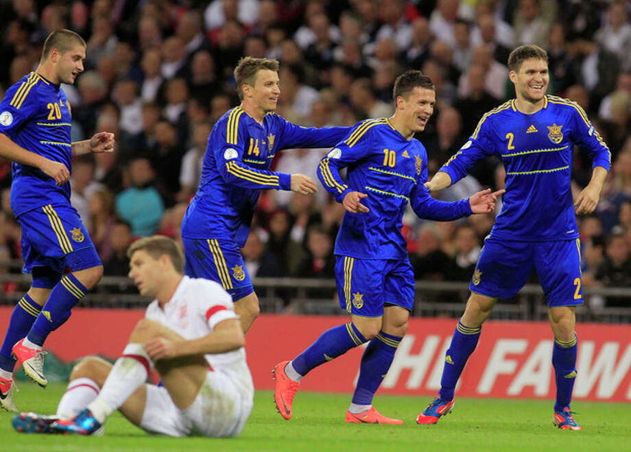 Ukraine's Levgenii Konoplianka, second right, celebrates his goal against England with teammates during their group H 2014 World Cup qualifying soccer match at Wembley Stadium, London, Tuesday, Sept. 11, 2012. (AP Photo/Sang Tan) / AP