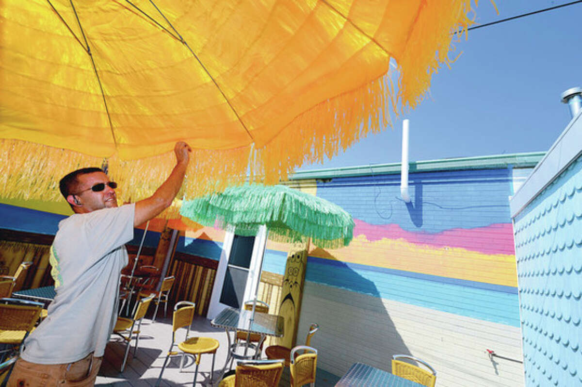 Hour photos / Erik Trautmann By the Sound Above and right, the new cafe at Calf Pasture Beach, Cafe Mu, recently had outdoor dining area added to the popular coffee shop with the help of the city's Recreation and Parks employee Ken Hughes.
