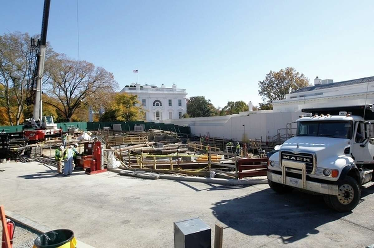 FILE - In this Nov. 9, 2011, file photo, construction continues in front of the West Wing at the White House in Washington. The White House Big Dig is finally wrapping up, but the Big Reveal is proving to be a pretty big letdown. After nearly two years and $86 million worth of noisy and disruptive construction, the West Wing has emerged from its visual seclusion remarkably unchanged. And deep underground, whatever has been built there remains shrouded in mystery. (AP Photo/Charles Dharapak, File)