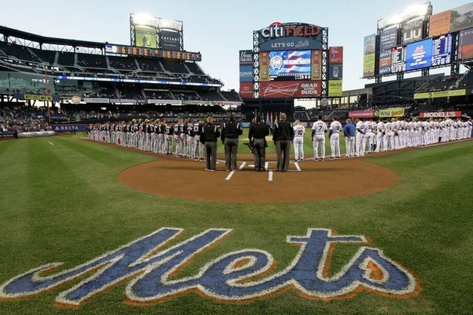 The Washington Nationals and the New York Mets line up for the playing of the national anthem before a baseball game Tuesday, Sept. 11, 2012, in New York. (AP Photo/Frank Franklin II) / AP