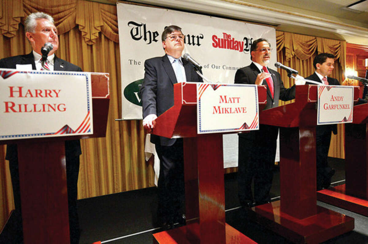 The four democratic candidates for mayor of Norwalk, Harry Rilling, Matt Miklave, Andy Garfunkel and Vinny Mangiacopra, debate Friday morning at the Norwalk Inn in an event sponsored by The Hour. Hour photo / Erik Trautmann