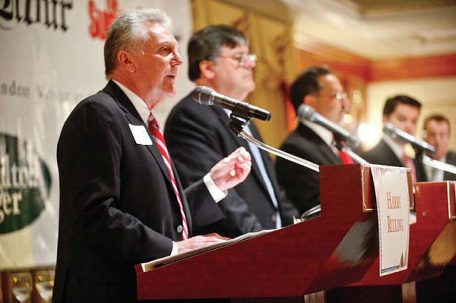 The four democratic candidates for mayor of Norwalk, Harry Rilling, Matt Miklave, Andy Garfunkel and Vinny Mangiacopra, debate Friday monring at the Norwalk Inn in an event sposnsored by The Hour.Hour photo / Erik Trautmann / (C)2013, The Hour Newspapers, all rights reserved