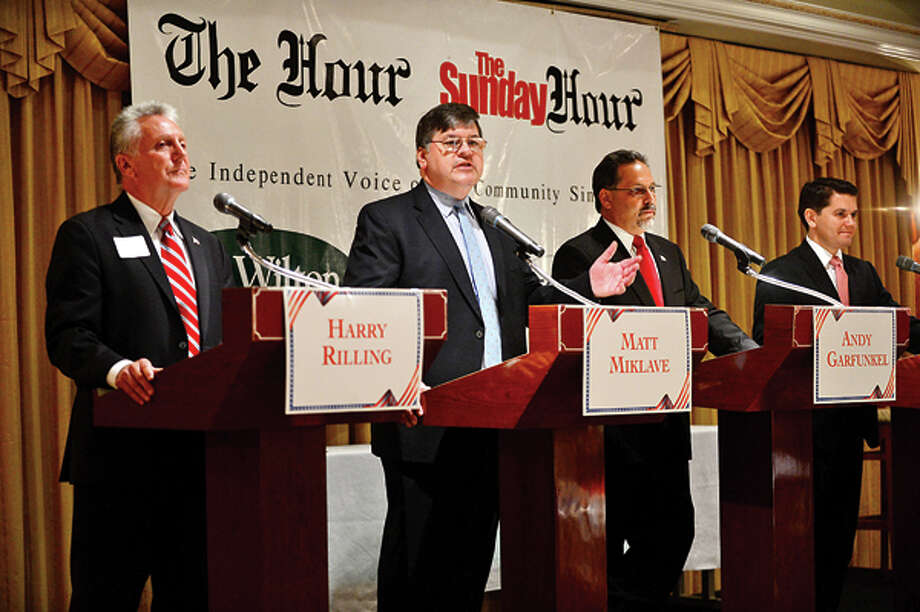 The four democratic candidates for mayor of Norwalk, Harry Rilling, Matt Miklave, Andy Garfunkel and Vinny Mangiacopra, debate Friday morning at the Norwalk Inn in an event sponsored by The Hour. Hour photo / Erik Trautmann / (C)2013, The Hour Newspapers, all rights reserved