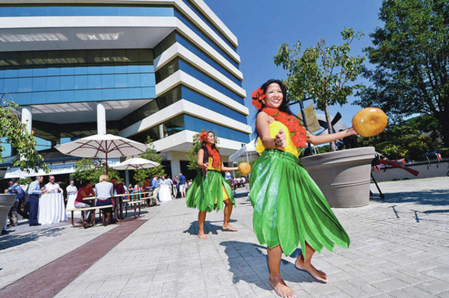 Hula dancers shake things up as part of Merritt 7 Corporate Park annual Tenant Appreciation Day Tuesday.Hour photo / Erik Trautmann / (C)2012, The Hour Newspapers, all rights reserved