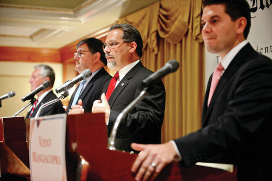 The four democratic candidates for mayor of Norwalk, Harry Rilling, Matt Miklave, Andy Garfunkel and Vinny Mangiacopra, debate Friday morning at the Norwalk Inn in an event sponsored by The Hour.Hour photo / Erik Trautmann / (C)2013, The Hour Newspapers, all rights reserved